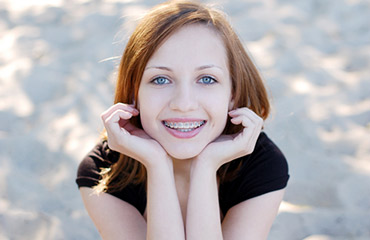 teen with braces smiling